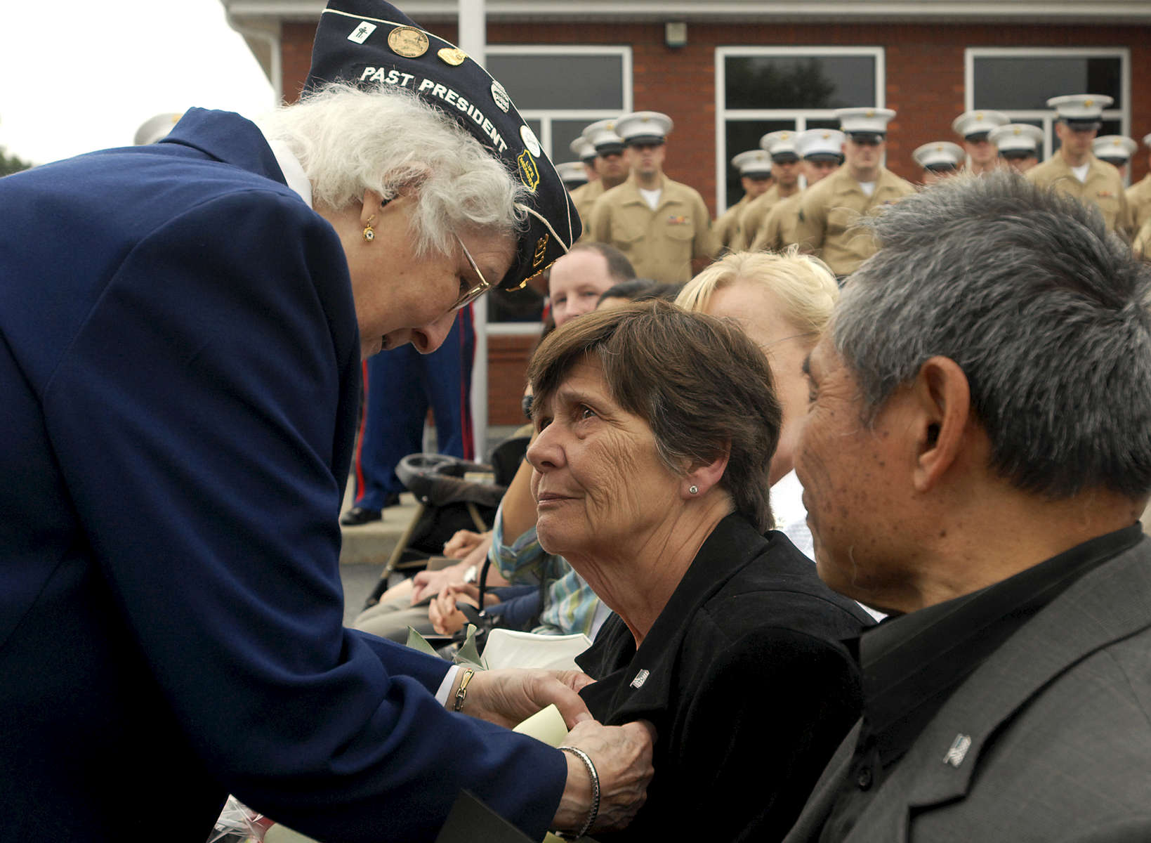 Hilda Levesque of Seekonk presents the Gold Star Mother pin to Anne-Marie Valdepenas, whose son was killed by a roadside bomb in Fallujah in 2006, during a post office dedication ceremony in his honor on Sunday, June 28, 2009. Ms. Levesque's son is currently on his second tour of Iraq and when she pinned Mrs. Valdepenas she said to her: {quote}From one Iraq War veteran's mother to another.{quote}