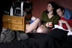 Matthew and his girlfriend, Hannah DeRemer, 20, have coffee in bed with his cat, Flannel, in their Boston apartment. Matthew is recovering from an orchiectomy from the day before. Doctors discovered that his remaining testicle was leukemic and needed to be removed a few days earlier. He lost his other testicle the year before during his first relapse.
