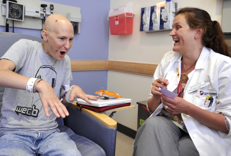Matthew Starring jokes around with nurse Ludmila Svoboda after learning that his latest bone marrow biopsy was negative for leukemia on Thursday, August 13, 2009. Ms. Svoboda asked Matthew to accompanyher to the WEEI/NECN telethon for the Dana-Farber Cancer Institute at Fenway Park. {quote}I thought you'd be the perfect one, I just love you,{quote} she said to Matthew.