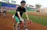 Matt Starring, 22, rode his bike around the warning track at Fenway Park with other Pan Mass Challenge riders and volunteers on Saturday, July 12, 2008. Starring registered as a rider in this charity bike ride for two years in a row, but because of his relapses he was not able to ride with his father as planned either year.