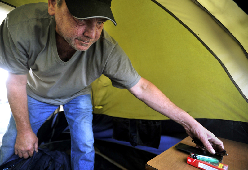 Ed Therrien, one of the founding members of Camp Runamuck, packs up his tent on Saturday afternoon.