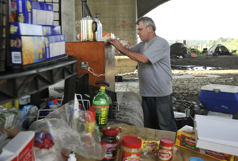 Ed Therrien, 52, the cook for Camp Runamuck, organizes the kitchen area on Thursday, July 30, 2009.