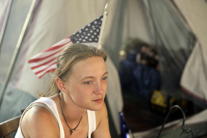 Rachell Shaw, 22, sits in a chair outside her tent under the Washington Bridge. She became homeless after she broke her hand and couldn't work her waitressing job anymore. {quote}I don't expect nothing from nobody. I'm the only one who can get myself out of my situation.{quote}