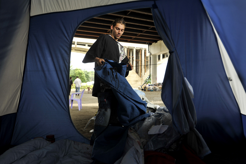Ralph Esposito III, who shares a tent with his father, cleans out the bedding in an effort to prevent rodent and pest infestation. He and his father were particularly upset about Freitas's latest arrest and said that the camp has lost donors over the controversy. {quote}We don't condone sex offenders.{quote} Esposito said.