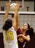 Tiverton High School's Jillian Cayer (16) spikes the ball as Barrington High School's Jessica Boukarim (19) jumps up to return it with a block on Thursday, November 5, 2009.
