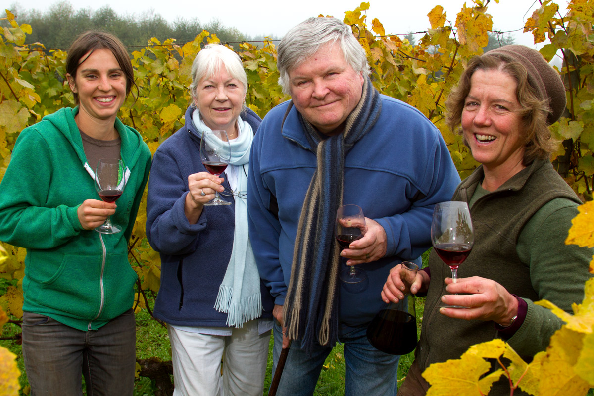 Founders Jo Ann and Gerard Bentryn (center left and right), of Bainbridge Island Vineyards and Winery with Robin Bedony (left) and Betsey Whittick (right). Several farms work on the 40 acre piece of land growing a diversity of crops including lettuce, garlic, beans, squash and potatoes. {quote}We all work cooperatively to create a local food community and culture.{quote} says Whittick.  {quote}Access to land is a challenge for young farmers.{quote} she said and Robin is part of the new generation of farmers, now a working member of Bainbridge Vineyards LLC.  Whittick is in the process of taking over the winery and vineyards operations. (© copyright Karen Ducey)