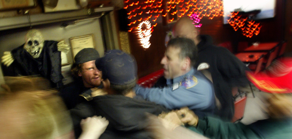 A patron is shoved out the door after a fight breaks out in the Elbow Room in Unalaska, AK. Opened in 1966, the Elbow Room had garnered a reputation as one of the most dangerous bars in America but today it has toned down as fishing seasons in the Bering Sea and Bristol Bay have been shortened and new bars have opened in this remote port of Dutch Harbor, AK. © copyright Karen Ducey