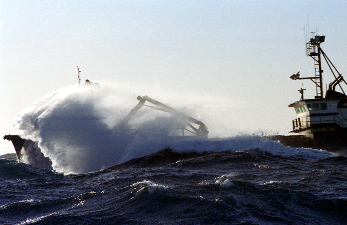 The fishing vessel {quote}Nowitna{quote} takes a wave over the bow during a storm during the Bering Sea opilio crab fishery in January and February of 1994.The Bering Sea is known for having the worst storms in the world. © copyright Karen Ducey