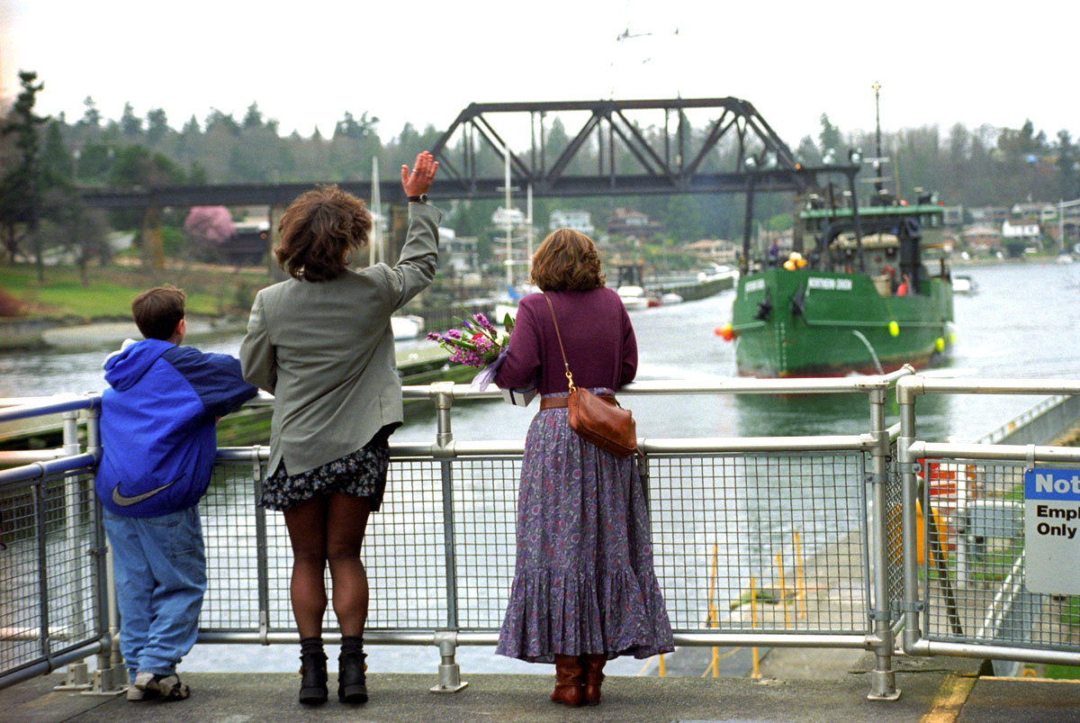 Families welcome crabber F/V Northern Orion as it approaches the Ballard Locks as it returns to Seattle after a crab season in the Bering Sea. © copyright Karen Ducey