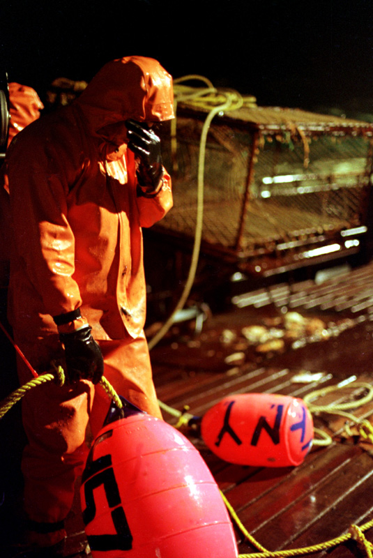 After working for 24 hours straight, a crewman onboard the fishing vessel {quote}Maverick{quote} rests his eyes as he awaits the signal to throw the buoy and dump the crab pot overboard during King Crab crab fishing season in the Bering Sea in November 1993. The Bering Sea is known for having the worst storms in the world. Nights are long and cold in the arctic in the winter.  Crab fishing in the Bering Sea is considered to be one of the most dangerous jobs in the world. This fishery is managed by the Alaska Department of Fish and Game and is a sustainable fishery.  The Discovery Channel produced a TV series called {quote}The Deadliest Catch{quote} which popularized this fishery. © copyright Karen Ducey