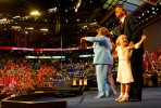 Senator John Edwards and his family including Emma Claire (in Photo) enjoys the crowd after he acceoted his nomination for Vice Preident at the Democratic National Convention in Boston,MA on July 28, 2004. (© copyright Karen Ducey)