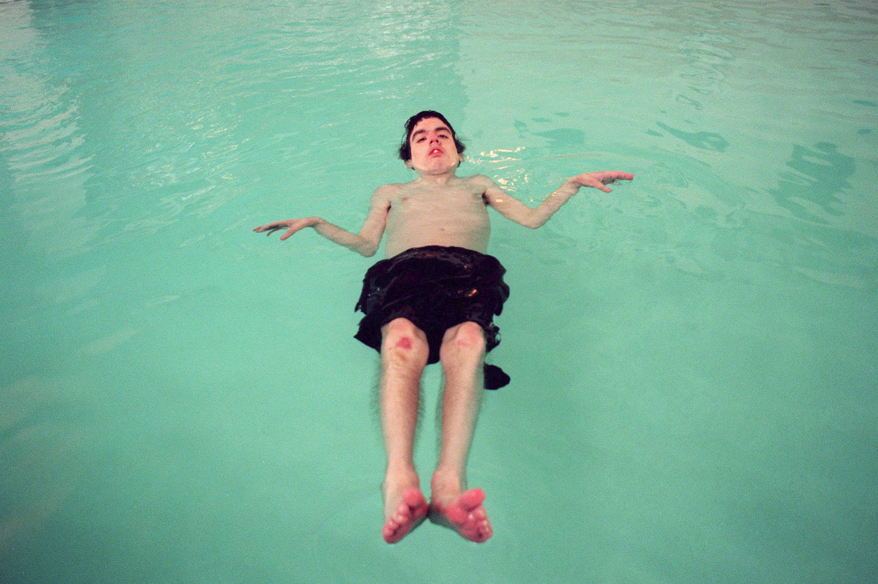 "When David Pyle is taken swimming each week, he floats- sometimes for the entire session. Born both deaf and legally blind, David,32, never acquired any tactual ASL language skills. In the water he experiences what therapists call ""body awareness""; a realization of his physical nature. David attended the Washington State School for the Blind, then entered the Seattle School District\'s deaf-blind program. He lives with a roomate in an apartment with 24-hour support services."