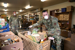 EDGEWOOD, WA - APRIL 4: Chief Allan Lawson (R) and Colonel Gent Welsh, both from the Washington Air National Guard, help distribute food with volunteers at the Nourish Pierce County food bank set up at the Mountain View Lutheran Church on April 4, 2020 in Edgewood, Washington. Members of the Washington National Guard have begun helping out at food banks across the state to assist with food distribution during the coronavirus (COVID-19) outbreak. Guard personnel fill a critical staffing shortage at a time when the need for food is increasing. (Photo by Karen Ducey/Getty Images)