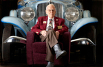 Howard Bates, age 92, sits in front of a 1932 Auburn 8 cylinder convertible at the Auburn Cord Duesenberg Museum where he works as a docent.  Indiana's luxury car industry flourished through the depression but didn't survive the industry trend toward inexpensive, mass produced vehicles introduced afterwards.