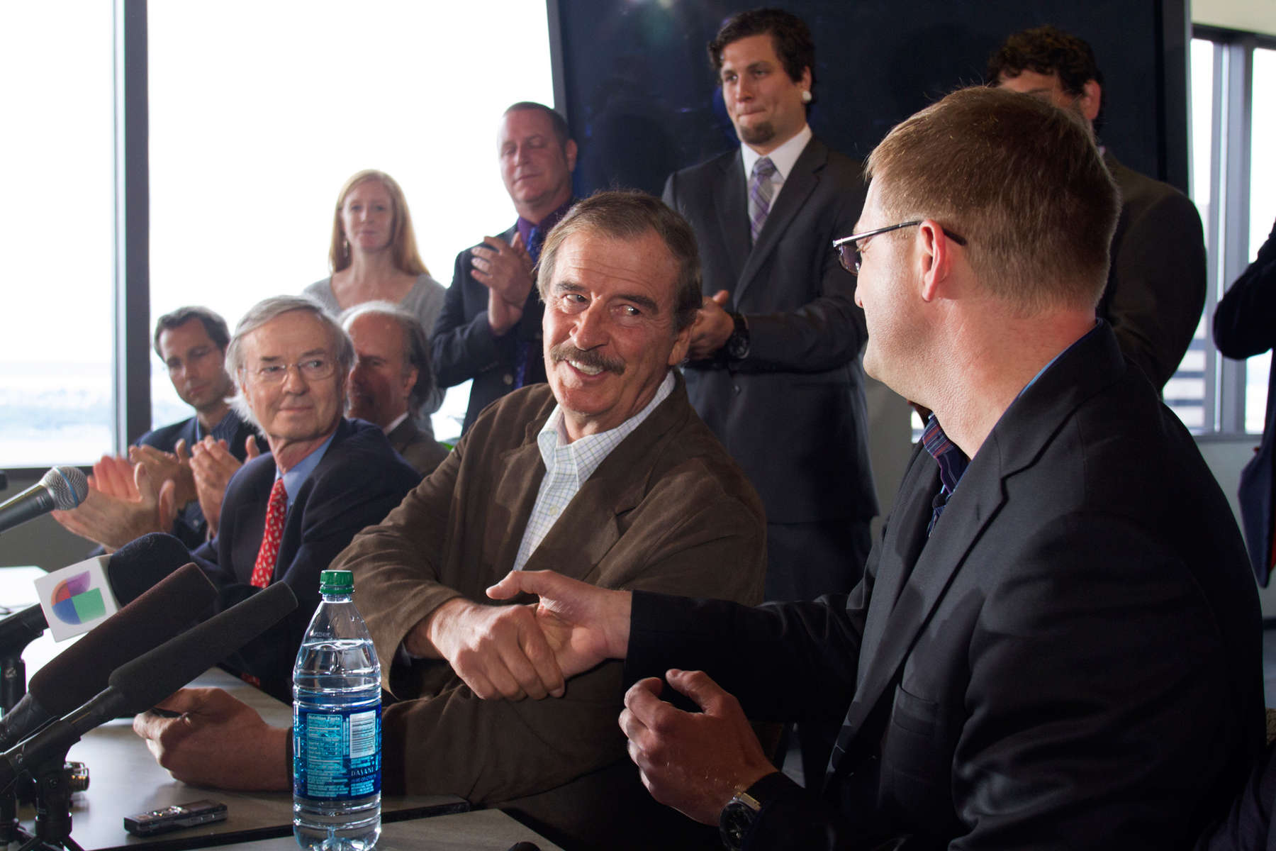 Former Mexican President Vicente Fox (left) shakes hands with  Jamen Shively, (right) Founder and CEO of Diego Pellicer, Inc. during a press conference with other marijuana industry leaders in the Columbia Tower, in Seattle, Wash. on May 30, 2013. (© copyright Karen Ducey)