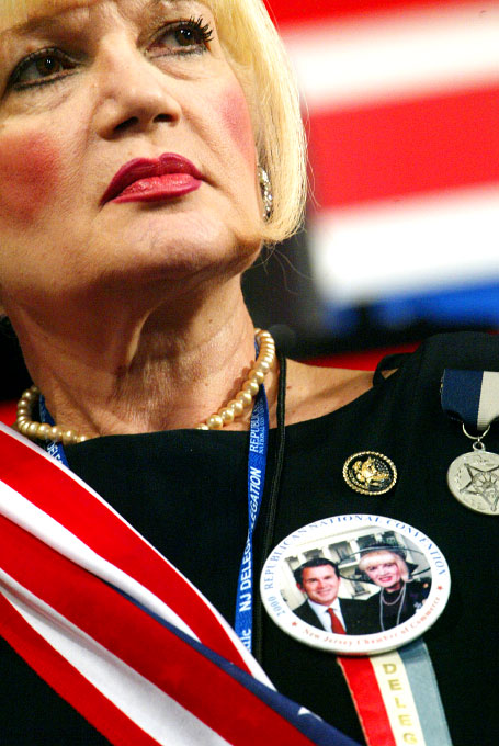Comtesse Suzanne de Paris, President and CEO of Suzanne de Paris Prodits waits for speeches to begin at the 2004 Republican National Convention in New York. Suzanne, a resident of New Jersey, is a {quote}staunch supporter of G.W. Bush{quote} and proudly wears her pin picturing she and the president taken in 2002. (© copyright Karen Ducey)