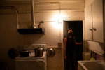 Angela Lee, stands in the kitchen of the home she grew up in in the Kong Yick Apartments  in the Chinatown - International District in Seattle, Washington on July 15, 2020. The apartment now belongs to her aunt. Donnie Chin, director of the International District Emergency Center (IDEC) was murdered on July 23, 2015. The murderer was never found. (Photo by Karen Ducey)