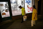 Volunteers of the night watch group in the Chinatown - International District in Seattle, Washington on July 20, 2020. The group numbers between 6 - a dozen volunteers a night who patrol the neighborhood  (Photo by Karen Ducey)