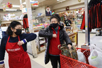 June Huynh (left) assistant manager, bumps elbows with Judy Lew as they greet each other at Viet-Wah, an Asian grocery store located in Seattle's Little Saigon neighborhood, on February 24, 2021 in Seattle, Washington. Bumping elbows instead of shaking hands or hugging, became the proper way to greet someone to help curb the spread of Covid-19. (Photo by Karen Ducey)