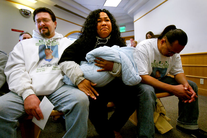 Weeks after Michael's death, Michael and Jordan's parents, Tim Miller, left, Lena Jantoc, and Jordan's biological father, Lorenzo Jantoc, react with relief in the King County Courthouse after a judge announced that Jordan would be placed under house arrest and could leave jail. Having lost Michael, they feared losing their other son, Jordan, into the adult prison system.    © Karen Ducey/ Seattle PI