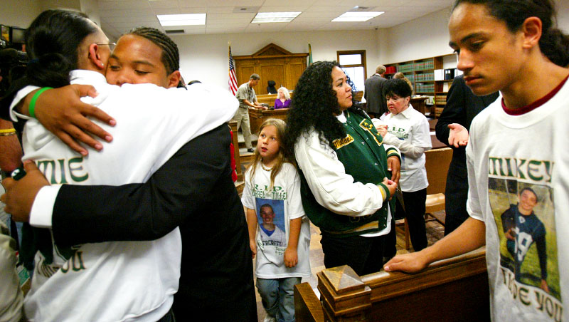 "Almost a full year after fatally shooting his brother, Jordan hugs relatives after a judge spared him from doing time in prison. ""This case is all too familiar,"" said Judge Harry McCarthy. ""Instances of young offenders having easy access, the lure of firearms and deadly consequences.""  He ruled that the interests of both the defendant and community would best be served by continued electronic home monitoring of Jordan for two years. After that time is served, Jordan and his father will be required to speak to the community about the dangers of firearms. {quote}In court it's kind of scary,{quote} he says {quote}and having my family there definitely helps because I know that they're supportive and will be with me forever.{quote}    © Karen Ducey/ Seattle/PI"