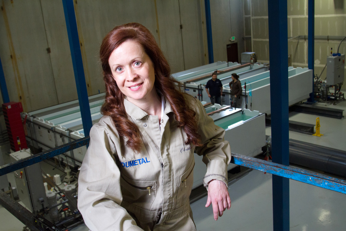 Christina A. Lomasney, CEO of MODUMETAL, Inc, poses in front of the processing line. (© copyright Karen Ducey)