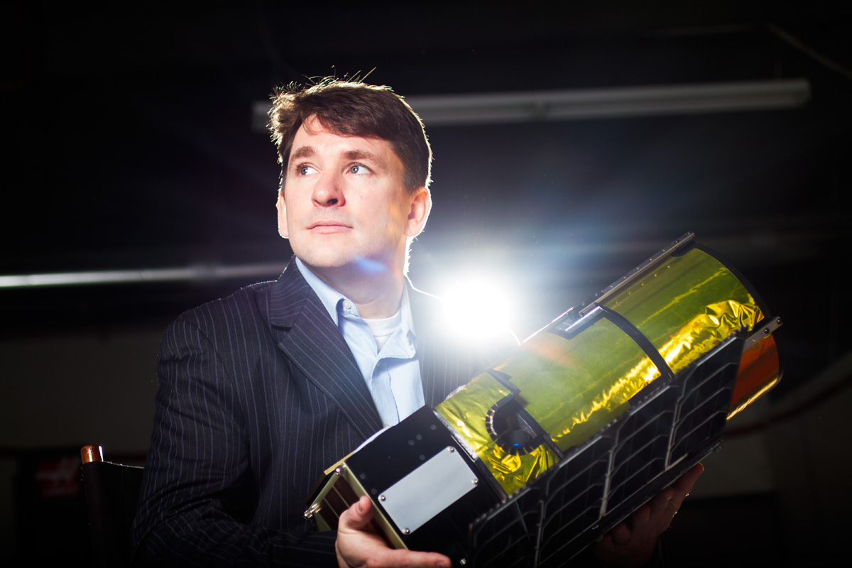 Chris Lewicki, President of Planetary Resources, is photographed with a model of a satellite in Bellevue, WA. (© copyright Karen Ducey)