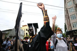 SEATTLE, WA - JUNE 19: Latio Cosmos (L), who recently graduated from Seattle University with a degree in public affairs, participates in the Juneteenth Freedom March and Celebration  on June 19, 2020 in Seattle, Washington. Juneteenth commemorates June 19, 1865, when a Union general read orders in Galveston, Texas stating all enslaved people in Texas were free according to federal law. (Photo by Karen Ducey/Getty Images)