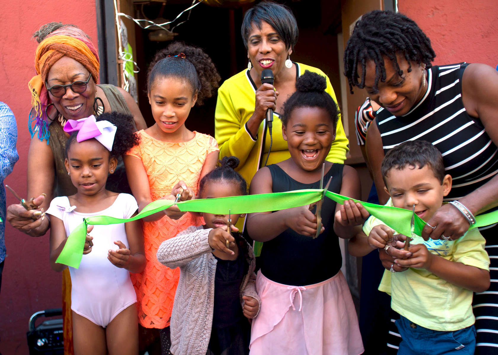 From left to right back row adults: Klair Etheridge, Pamela Lewis-Bridges, Joye Hardiman, PhD, Patricia Corbert. Children left to right: DianaStarr Robinson, 6, Ashea Nougera, 9, Olivia Frieson, 7, Kabby Mitchell Everly (fifth generation), 6, cut the ribbon marking the grand opening of the Tacoma Urban Performing Center (T.U.P.A.C.) on Saturday, July 8, 2017 in Tacoma, WA.. Kabby Mitchell, founder of T.U.P.A.C., lived in Tacoma, taught at The Evergreen State College and was the first African-American Principle Dancer for the Pacific Northwest Ballet. Kabby, unexpectedly passed away on May 4, 2017. Professional dance instruction will be offered there. (© Karen Ducey)