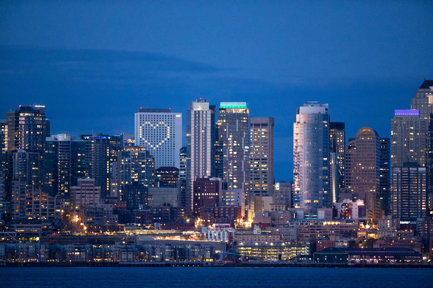 SEATTLE, WA - APRIL 06: The Seattle skyline is seen at sunset on April 6, 2020 in Seattle, Washington. Windows of the Hyatt Regency Hotel are lit up in the shape of a heart. Washington State Governor Jay Inslee extended the Stay at Home order until May 4th to help slow the spread of coronavirus (COVID-19). (Photo by Karen Ducey/Getty Images)