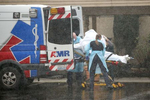 KIRKLAND, WA - MARCH 07: A patient is shielded from the rain as they are put into an ambulance outside the Life Care Center on March 7, 2020 in Kirkland, Washington. Several residents have died from COVID-19 and others have tested positive for the novel coronavirus. (Photo by Karen Ducey/Getty Images)