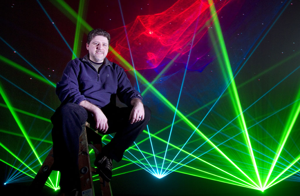 Laser light artist, John Borcherding, poses for a portrait at the Pacific Science Center. (© copyright Karen Ducey)