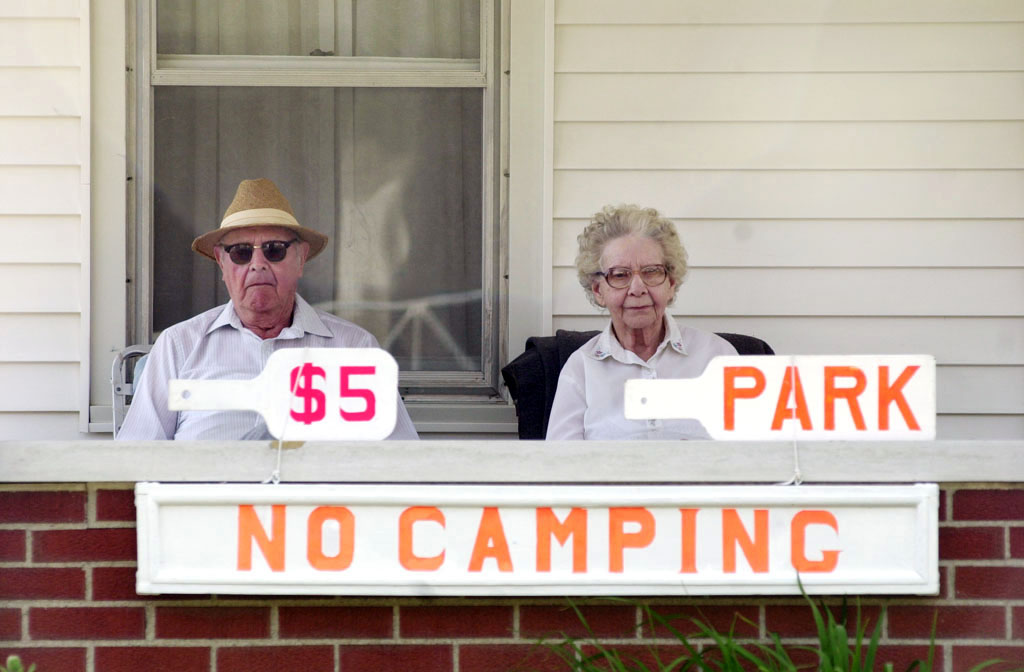 A couple offers $5 parking spaces in their yard outside the Indianapolis 500. (© copyright Karen Ducey)