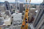 Ironworkers on the crane aofthe Washington Mutual building, WaMu Center, as it was being constructed.