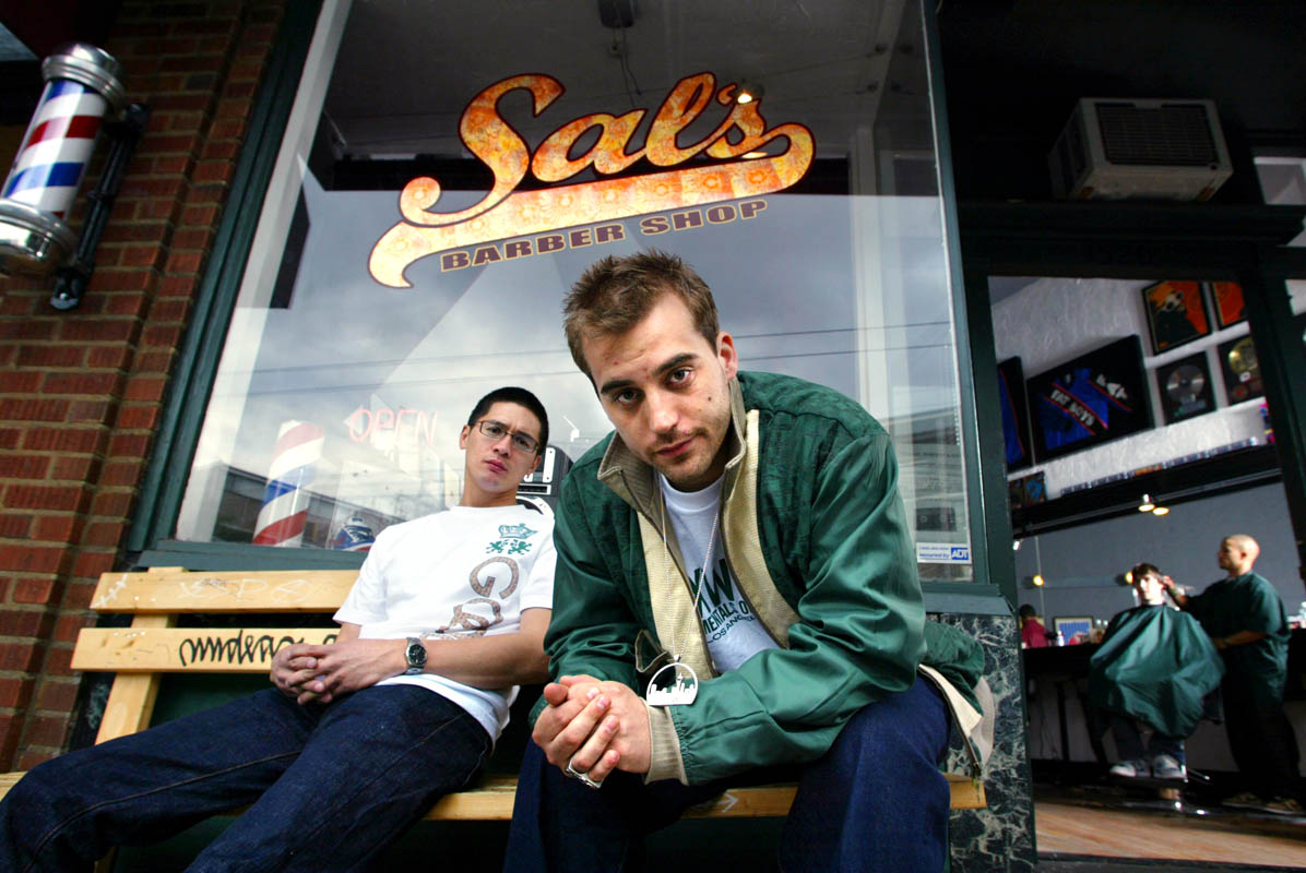 Sal's Barber Shop owners Brian Rauschenbach, left, and Marcus Lalario have groomed their business to cater to the hip-hop crowd, with music in the air and memorabilia on the walls. (© copyright Karen Ducey)