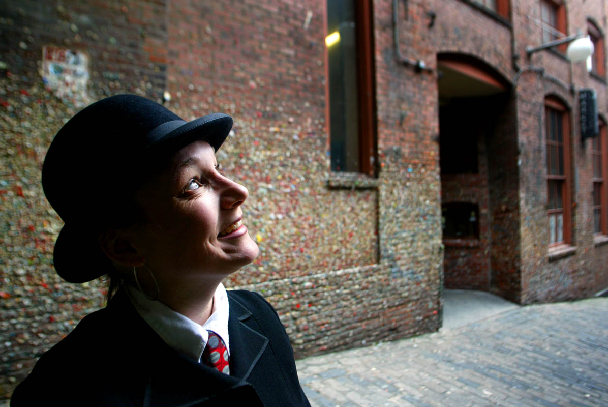 Mercedes Yaeger of Market Ghost Tours says ghosts have been seen in the Market Theater in Post Alley behind her in Seattle, Wash. (© copyright Karen Ducey)