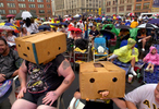 Fred Drake (left) and Aaron Drake (right), age 11, use boxes to shield their heads during the heavy rains which drowned Pacers fans prior to Game 4 of the NBA Finals.  The large screen viewing party across the street from Conseco Fieldhouse attracted thousands of people despite the poor weather. (© Karen Ducey/Indianpolis Star)