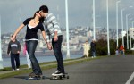 Angie Sherbina, 16, and her boyfriend Rod Lats,19, both from Federal Way, WAsh., skateboard along Alki Beach on Harbor Ave. and Alki Ave. SW on Valentines Day on February 14, 2008.