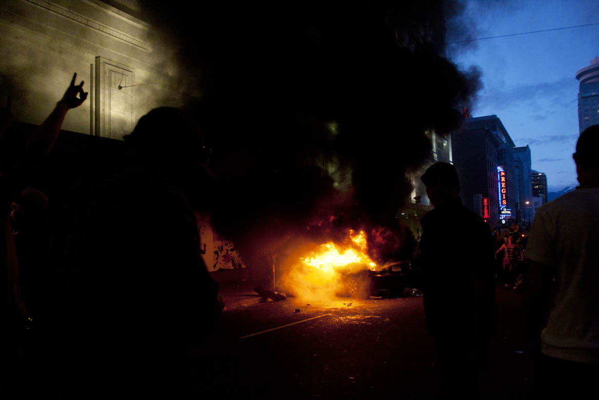 Rioters loot stores and burn cars in downtown Vancouver,BC after the Canucks were defeated by the Boston Bruins in the Stanly Cup on June 15, 2011. (© copyright karen Ducey)