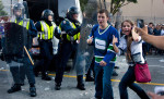 What's a party to some is serios business to others as Canuck's fans give a thumbs up police appear concerned of the growing riot on the downtown streets of Vancouver,BC after the Canucks were defeated by the Boston Bruins in the Stanly Cup on June 15, 2011. (photo copyright Karen Ducey)