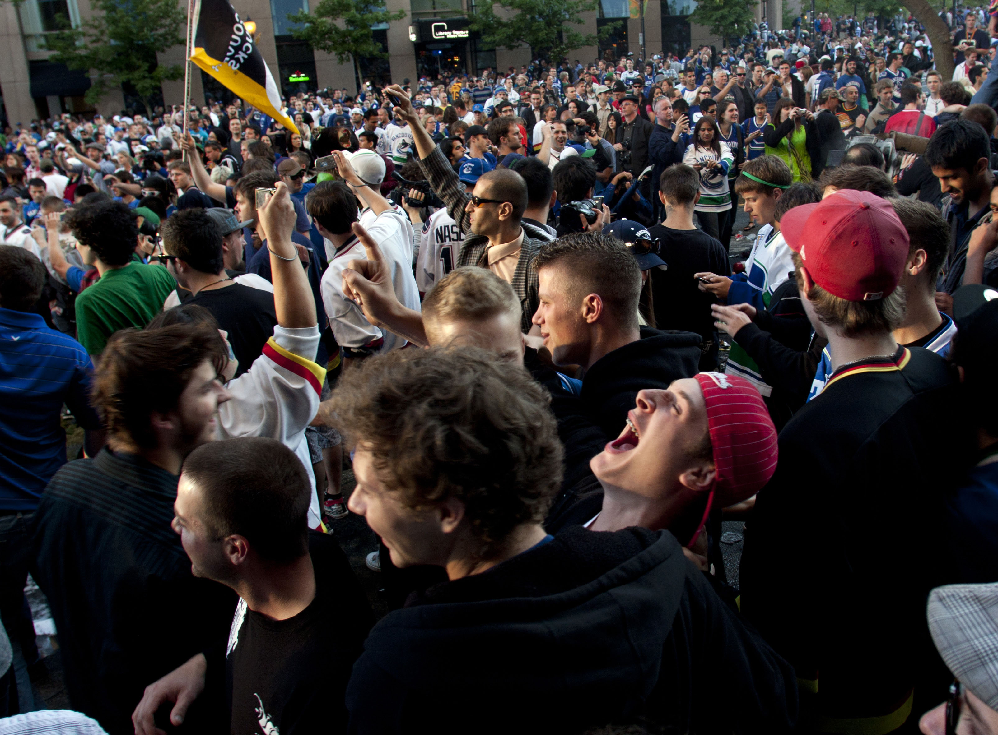 As a riot starts to begin the crowd gets rowdy on downtown streets of Vancouver,BC after the Canucks were defeated by the Boston Bruins in the Stanly Cup on June 15, 2011. (photo copyright Karen Ducey)