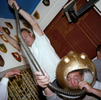 A male guest at a wedding reception in a St Ives rugby club drinks a pint of Guinness and a large whisky through the tube of a deep-sea diver themed beer bong. May 2001