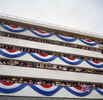 A crowd sings patriotic English songs from the stands at Royal Ascot. June 2002