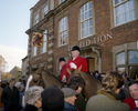 A huntsman has an early morning drink outside the Red Lion pub in the Wiltshire town of Malmesbury. December 2001