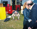 A couple kiss while a man vomits nearby on Derby Day at Epsom Downs Racecourse. June 2001