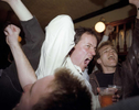 In a south London pub, England football fans celebrate a goal during a World Cup qualifier against Sweden. March 2001