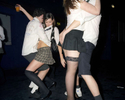Two young couples dance closely at schooldisco.com, a school disco-themed adult night out in north London. April 2007