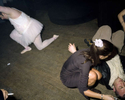 A male entertainer dressed as a ballerina performs in a central London nightclub next to a man lying on the floor. May 2000