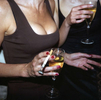 Two women drink champagne at a health resort launch party in central London. April 1998