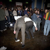Two male visitors to a beer festival organised by CAMRA in north London make their way towards the toilet. March 2001